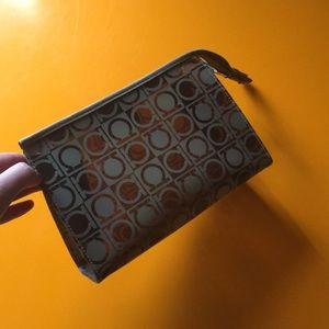 Salvatore Ferragamo transparent makeup pouch.
